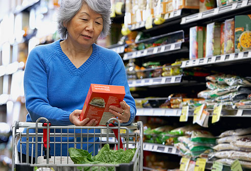 getty_rf_photo_of_woman_reading_food_label